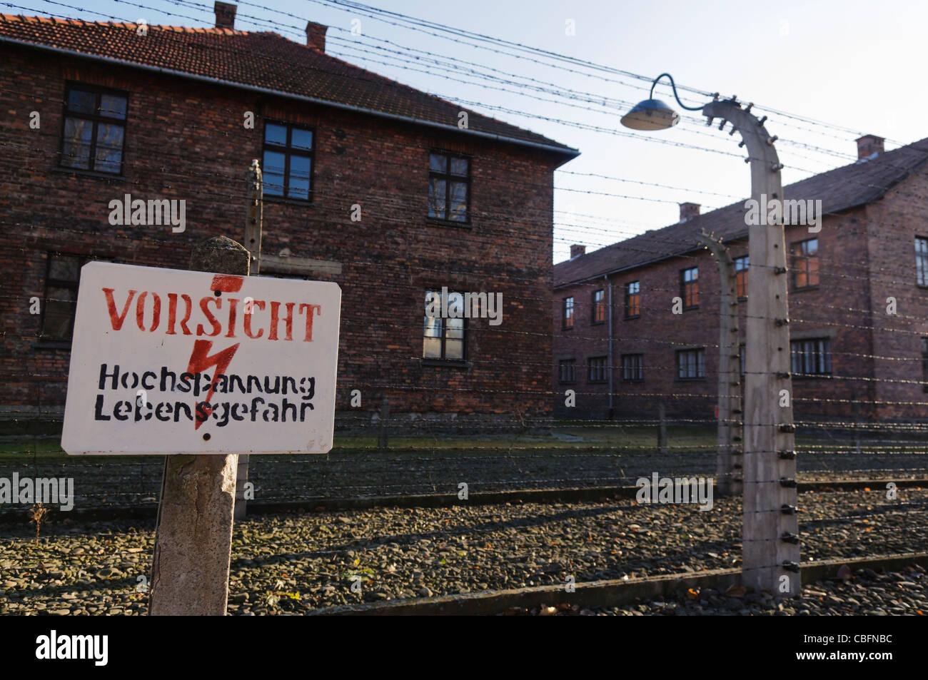 sign at barbed wire electric fence in auschwitz vorsicht hochspannung lebensgefahr danger high voltage