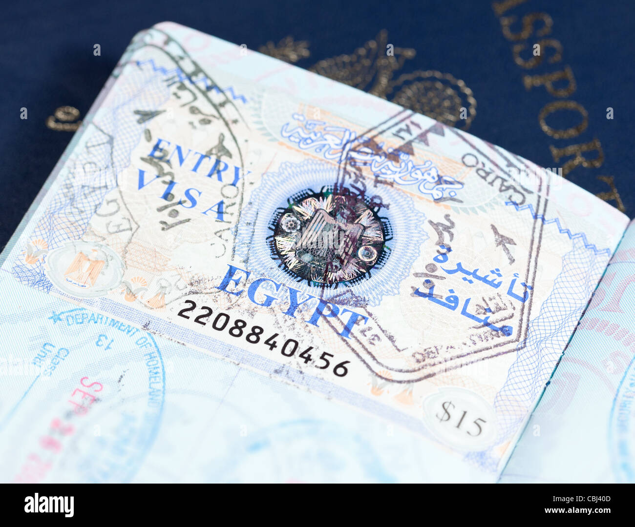 macro image of visa and immigration stamps in us passport for