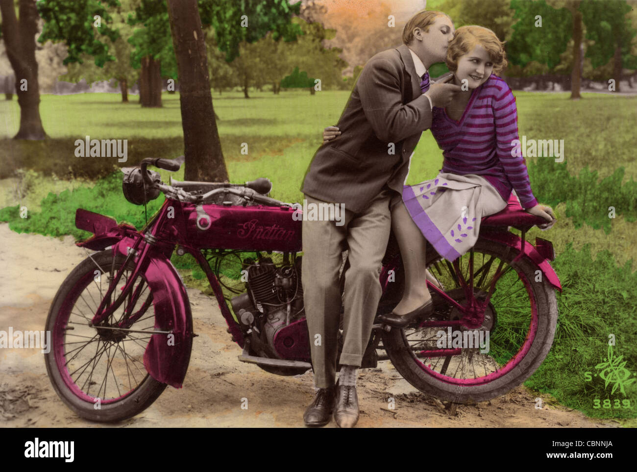 stock photgraph of couple on vintage motorcycle