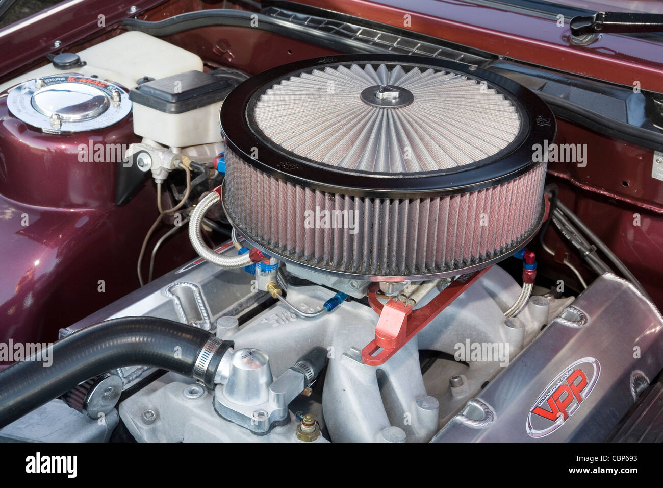 Custom Automotive Air Cleaners : Circular air filter cleaner in the engine bay of a