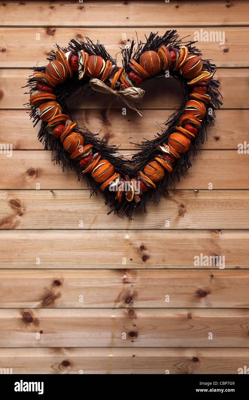 A heart shaped fruit christmas wreath on a wooden front door stock heart shaped wreath bath christmas market england stock photo rubansaba