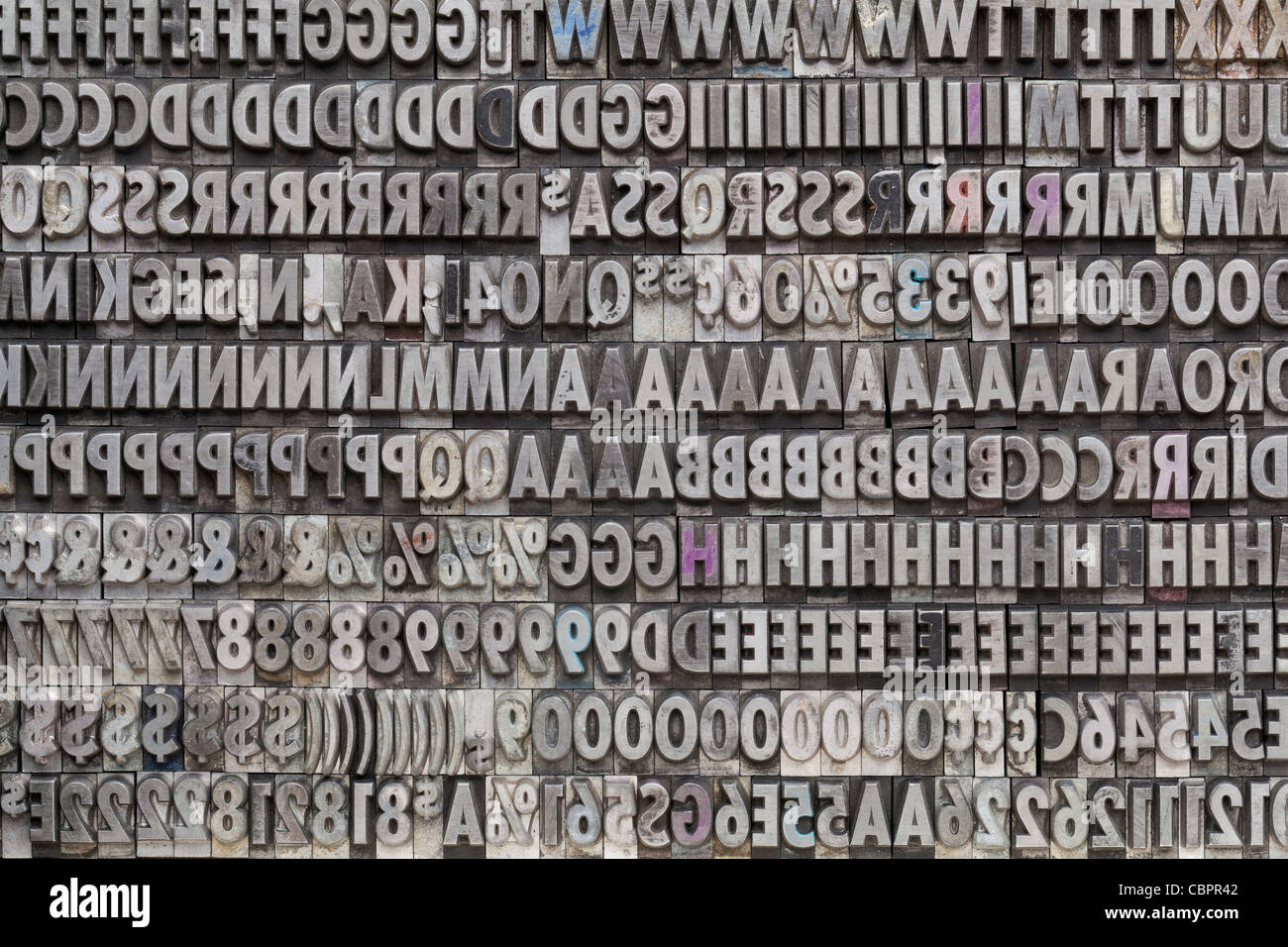 Background of letters numbers and punctuation symbols in old background of letters numbers and punctuation symbols in old grunge metal movable typeset biocorpaavc