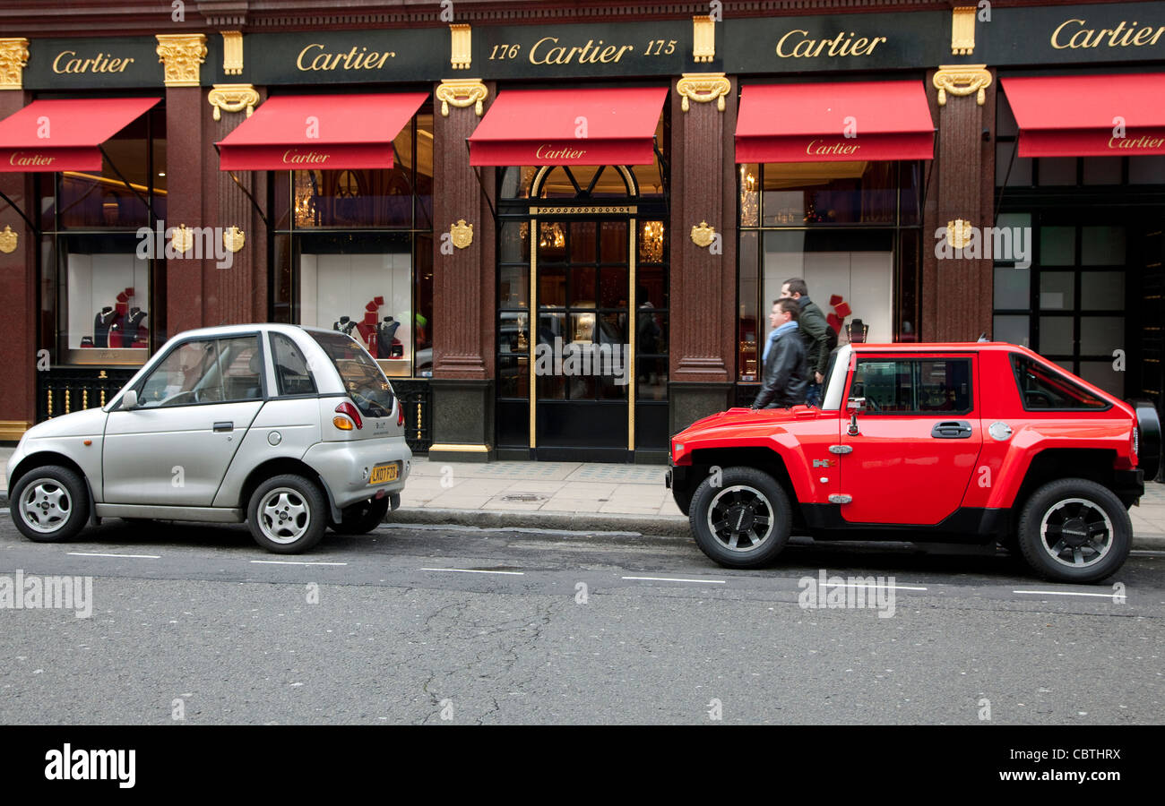 tiny cars including g wiz electric and hummer hx parked outside stock photo royalty free image. Black Bedroom Furniture Sets. Home Design Ideas