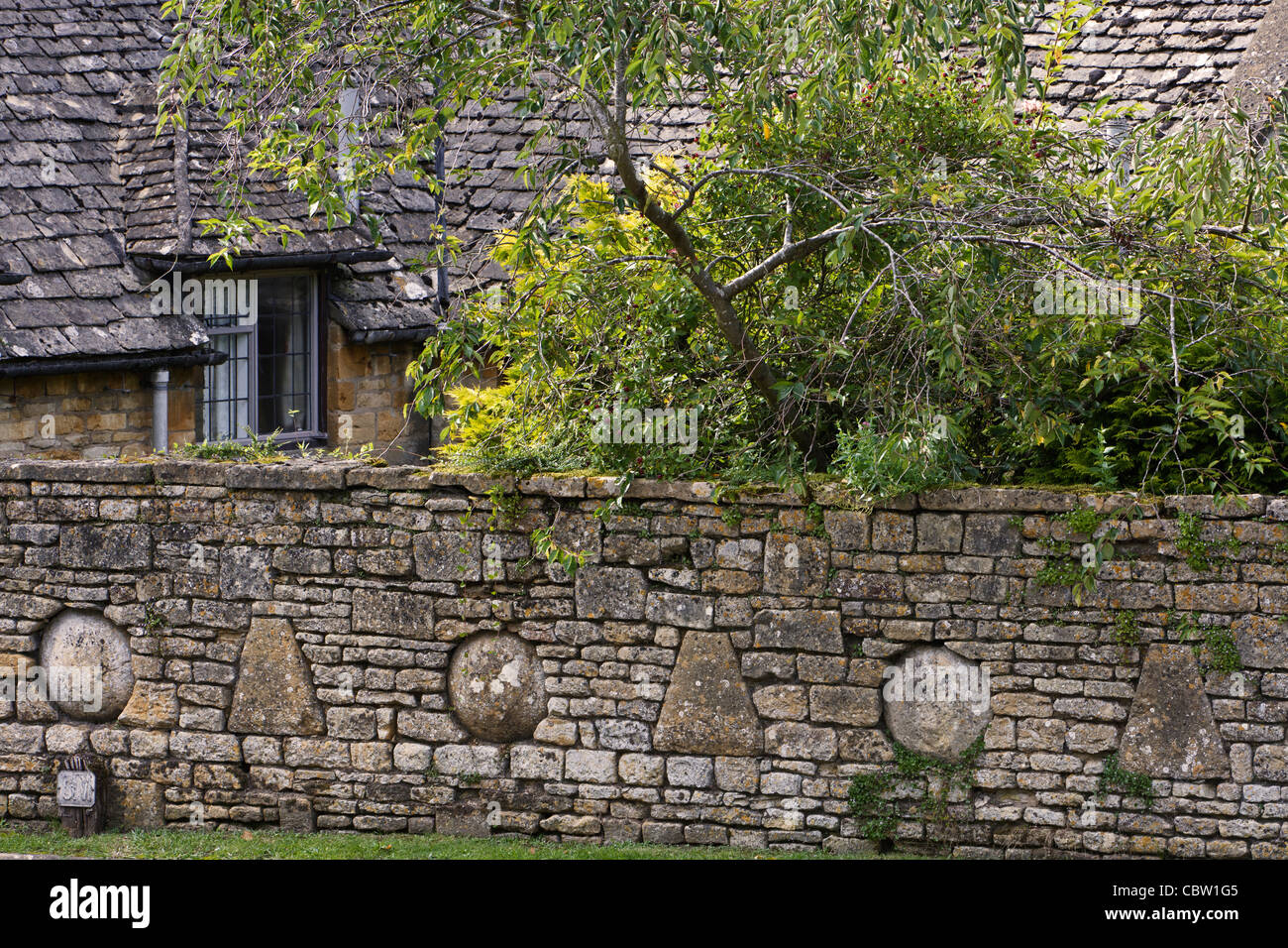 Building a decorative stone wall images home wall decoration ideas decorative stones embedded in a cotswold dry stone wall in the decorative stones embedded in a amipublicfo Choice Image