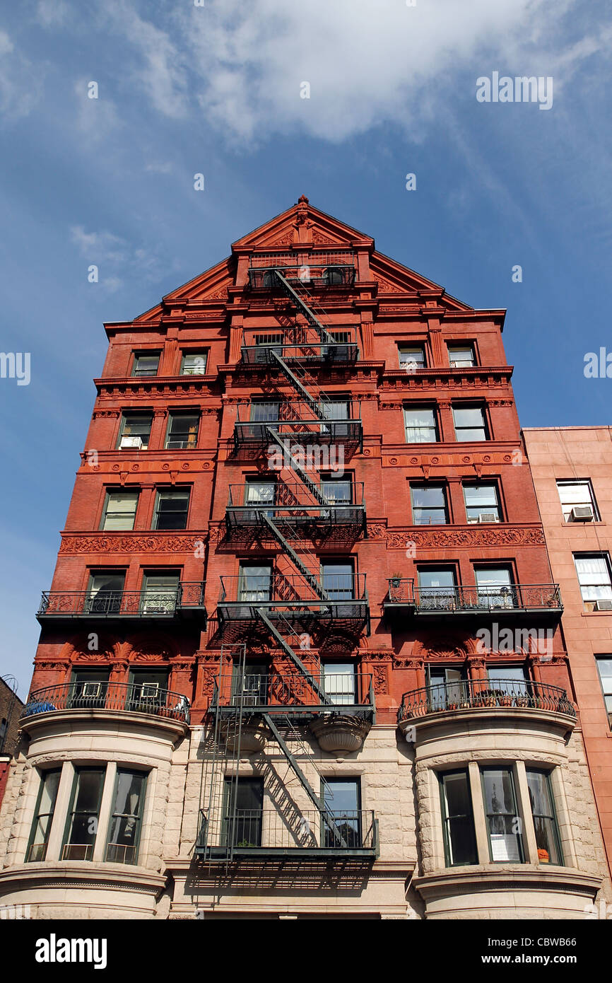 A Tall Red Building With A Peaked Roof. Brooklyn, New York City