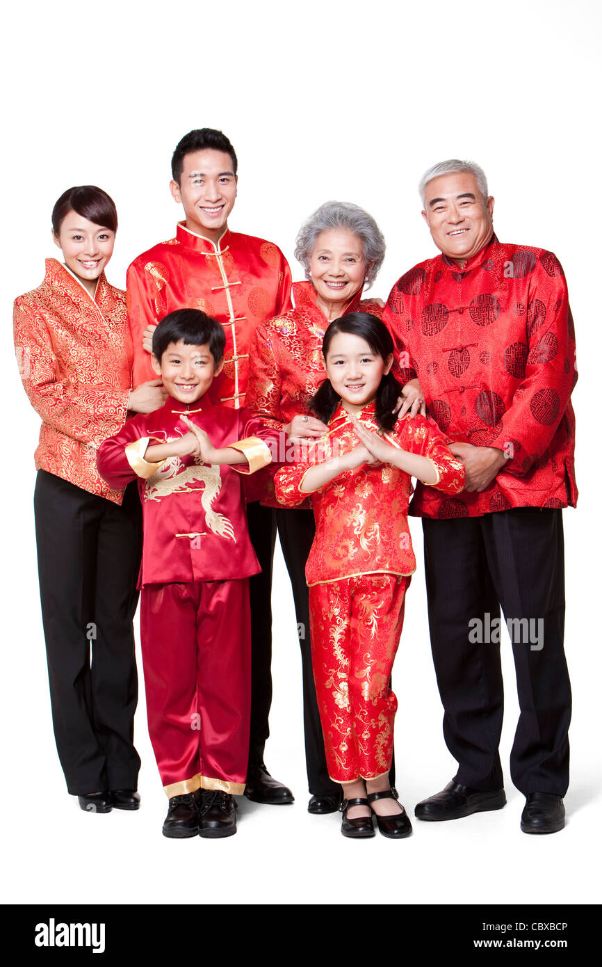 family dressed in traditional clothing celebrating chinese new year stock photo royalty free. Black Bedroom Furniture Sets. Home Design Ideas
