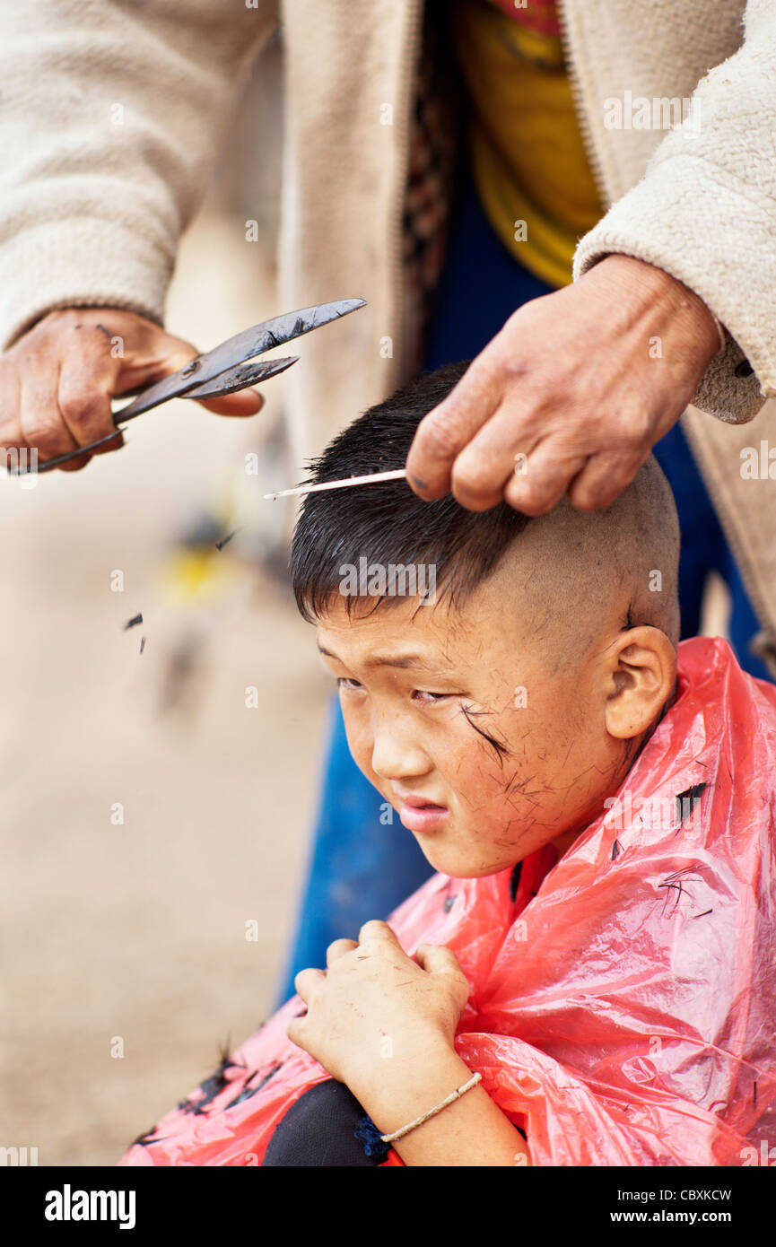 Palong Boy Getting A Haircut At The Road Side In Norlae Village Northern Thailand Asia