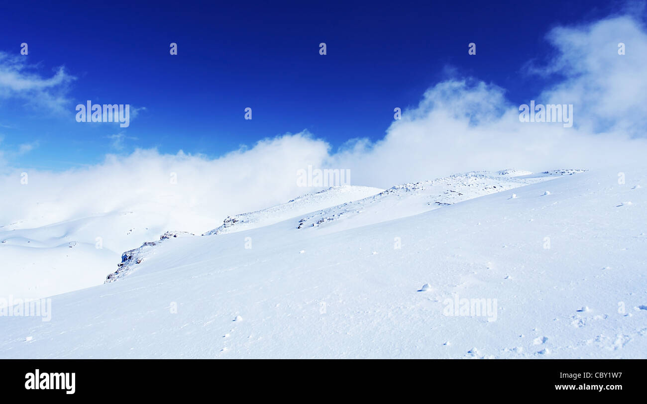 Winter landscape of high mountains with snow blizzard and fresh winter landscape of high mountains with snow blizzard and fresh blue sky beautiful nature panoramic background voltagebd Choice Image