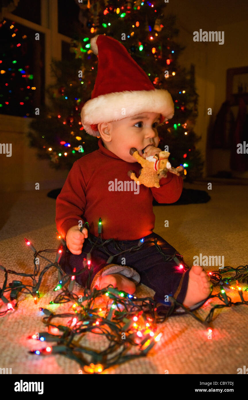 Seven Month Old Baby Boy With Christmas Lights And Wearing