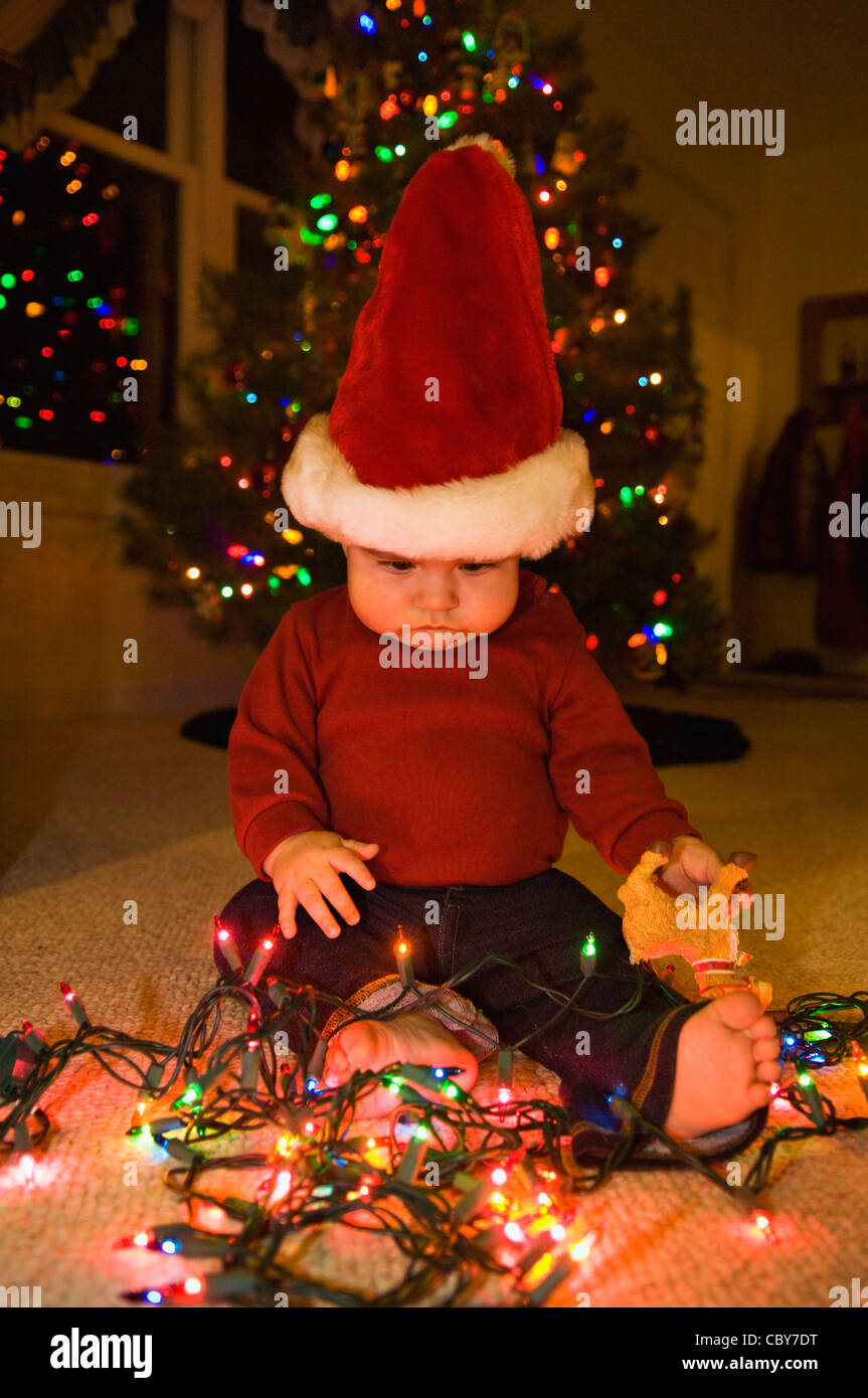 Seven Month Old Baby Boy With Christmas Lights And Wearing Santa  - Baby With Christmas Lights