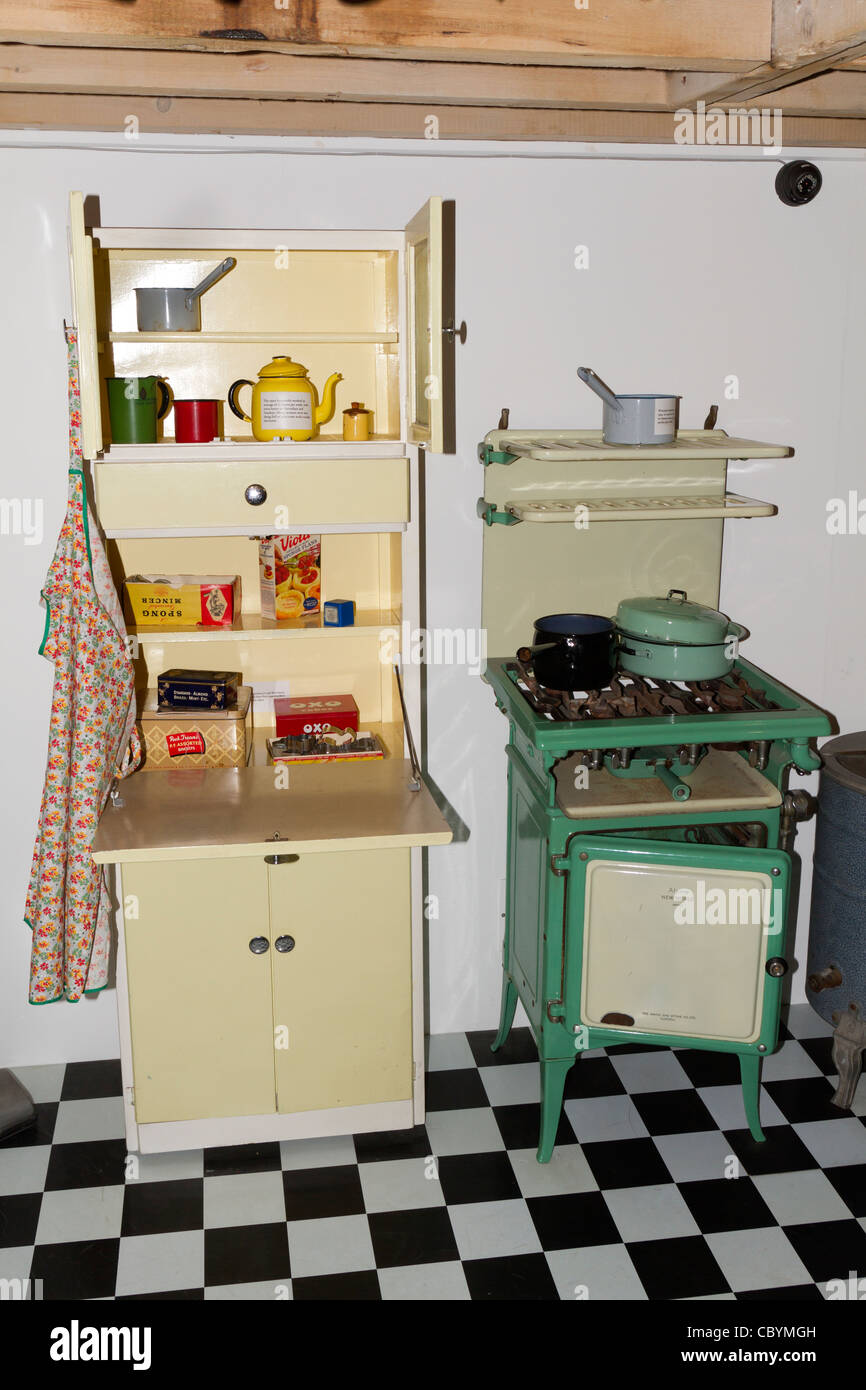 50u0027s and 60u0027s kitchen cupboard and cooker on display in a museum in poole stock