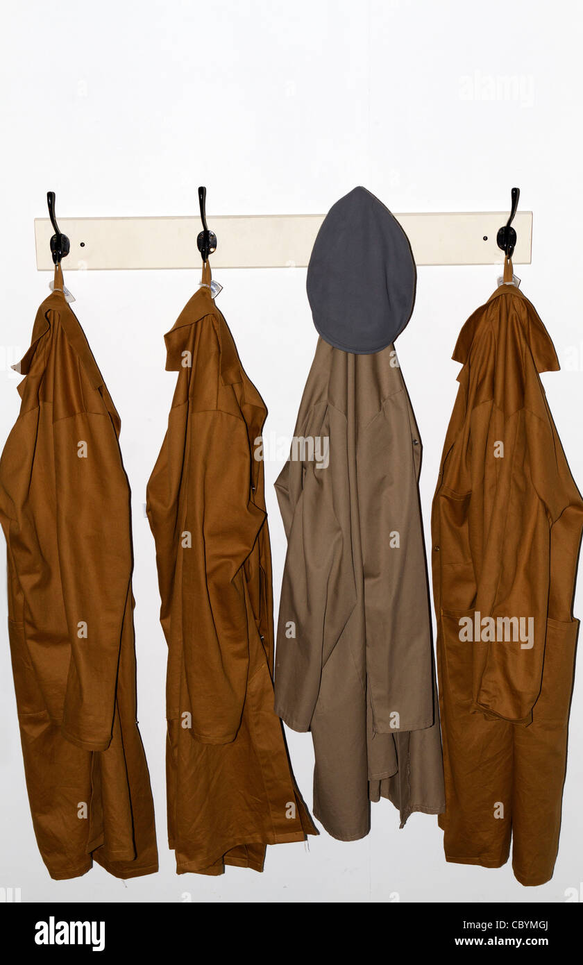 Four overall coats hanging up in Poole museum Stock Photo, Royalty ...
