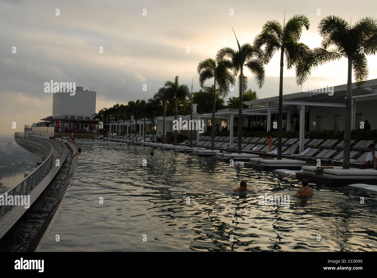 Sands skypark infinity swimming pool on the 57th floor of marina bay stock photo royalty free for Swimming pool equipment singapore