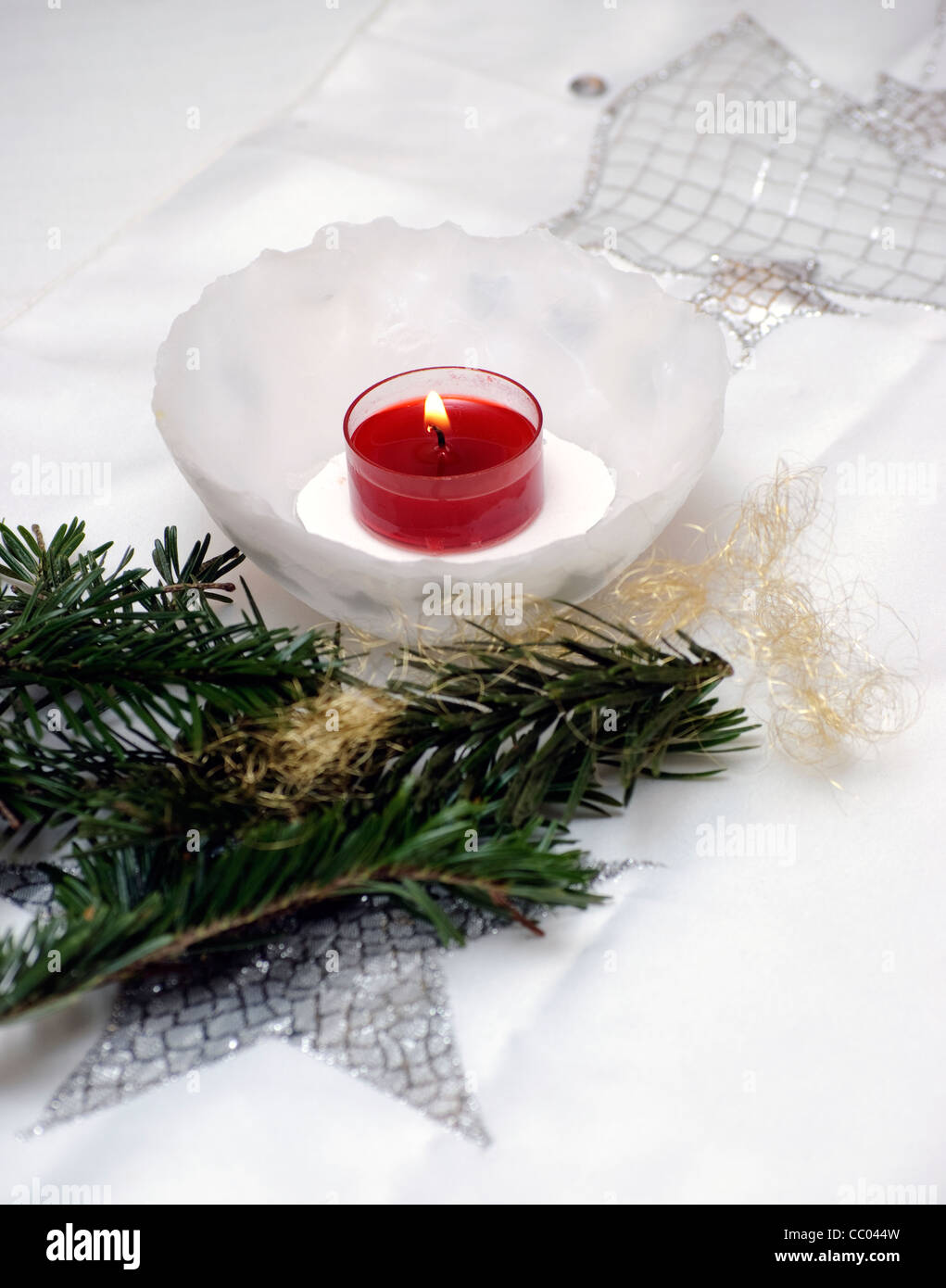 Christmas table decoration with a candle in a wax bowl for Decoration wax