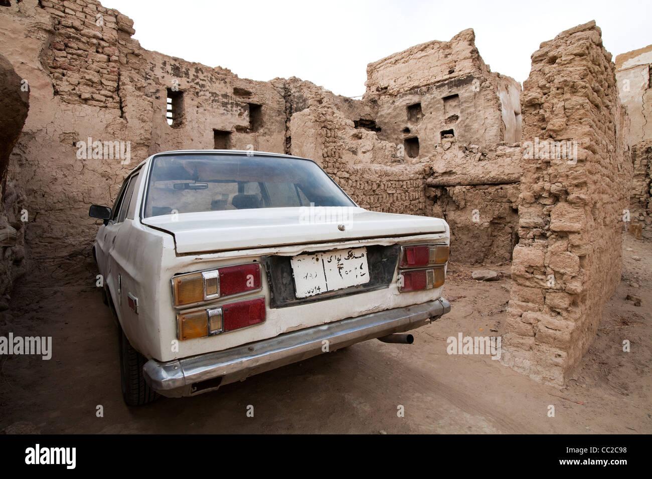 Old car parked in the historic village of El-Qasr at Dakhla Oasis ...