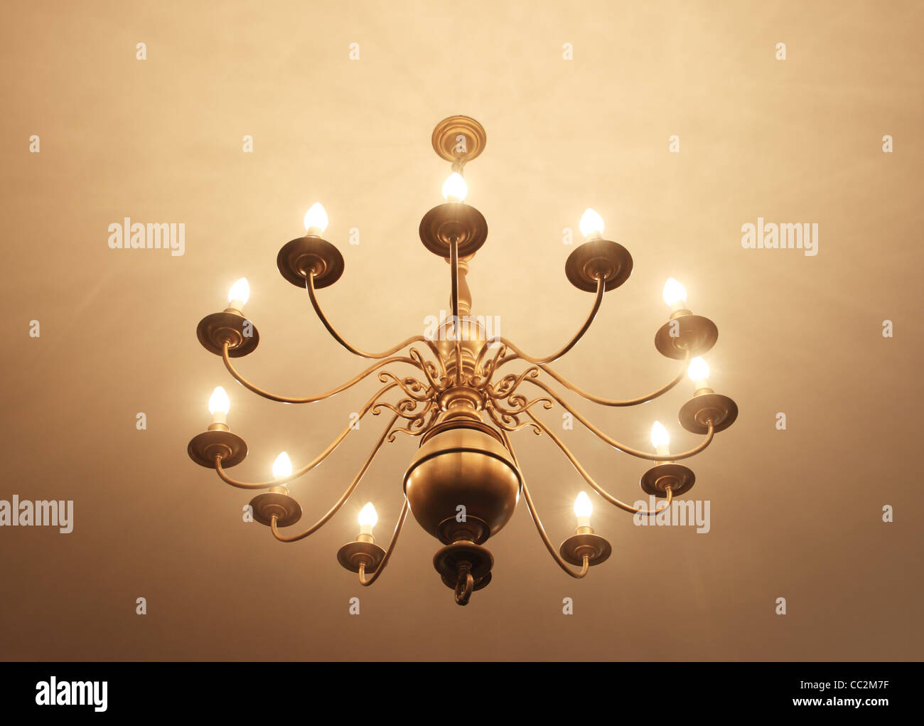 Brass chandelier hanging from ceiling with many lights stock photo brass chandelier hanging from ceiling with many lights arubaitofo Images