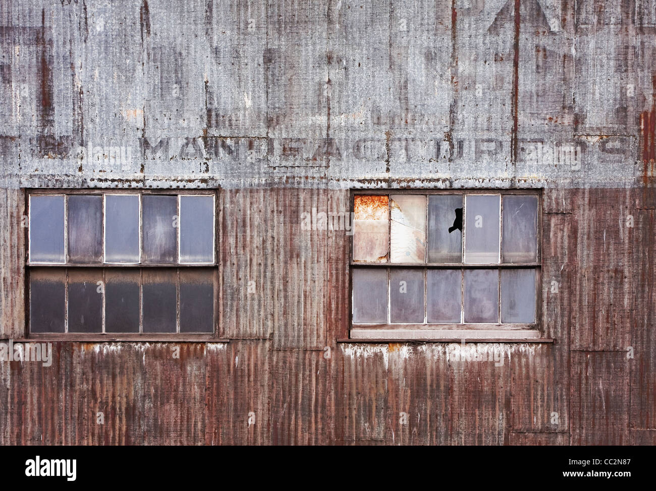 Old corrugated metal warehouse with two windows stock photo old corrugated metal warehouse with two windows sciox Image collections