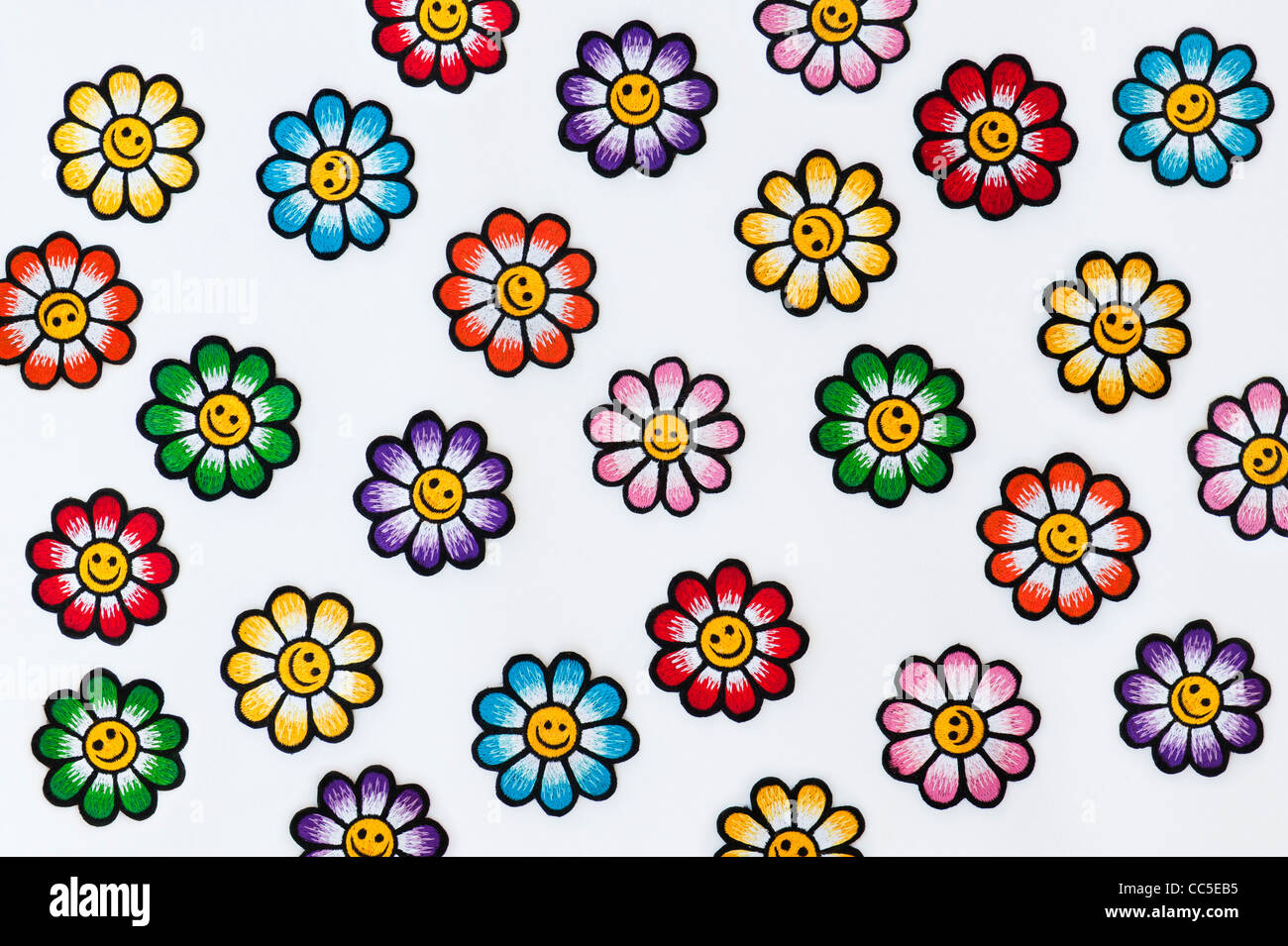Embroidery iron on patches of Multicoloured smiley face flowers on a Stock Ph