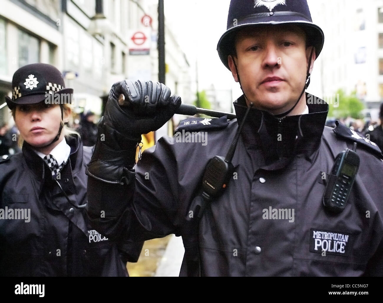 street policeman with baton raised editorial use only