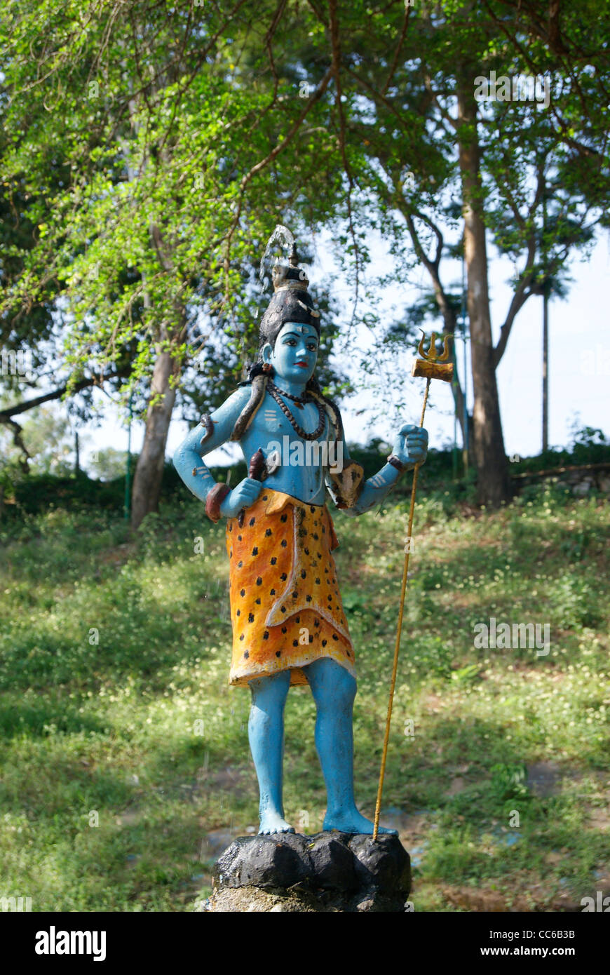 Hindu God Shiva Statue In The Beautiful Green Garden.Water(concept Of Ganga  River) Is Also Flowing From The To Head Of God