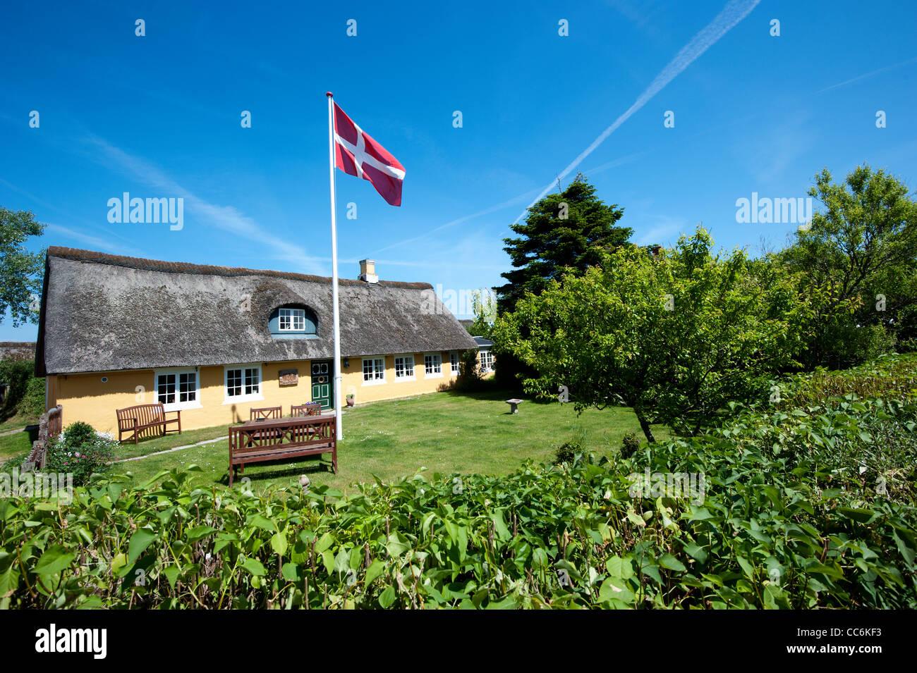 house and garden with danish flag in sonderho fano island