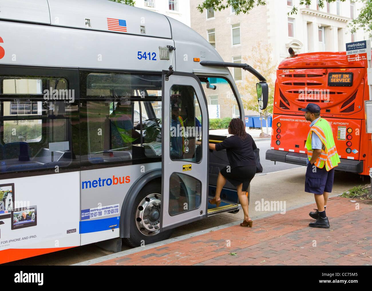 Metro Bus Cleaners Dc : A woman bus rider boarding metrobus washington dc usa