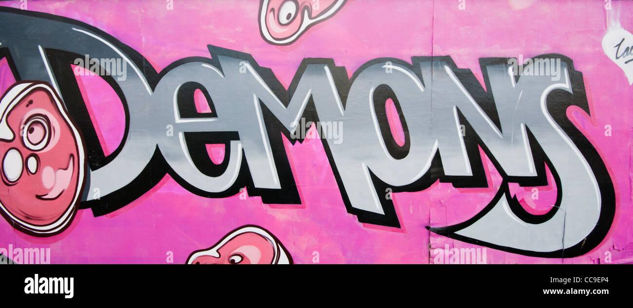 Graffiti wall writing - Brightly Coloured Colored Aerosol Spray Paint Graffiti Wall Art And Style Writing