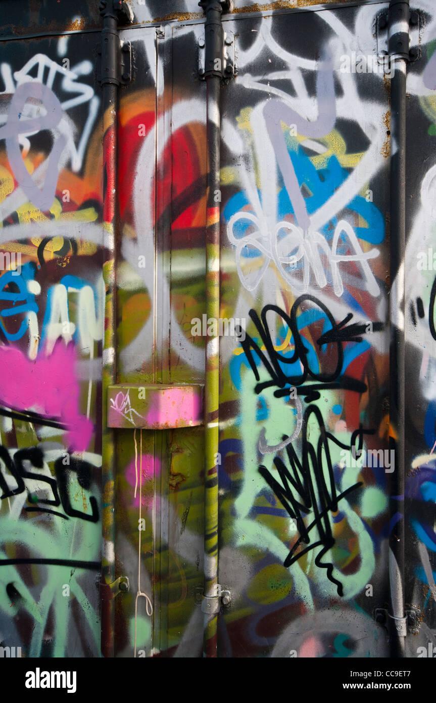 Graffiti wall writing -  Brightly Coloured Colored Aerosol Spray Paint Graffiti Wall Art And Style Writing Tags Stock Photo