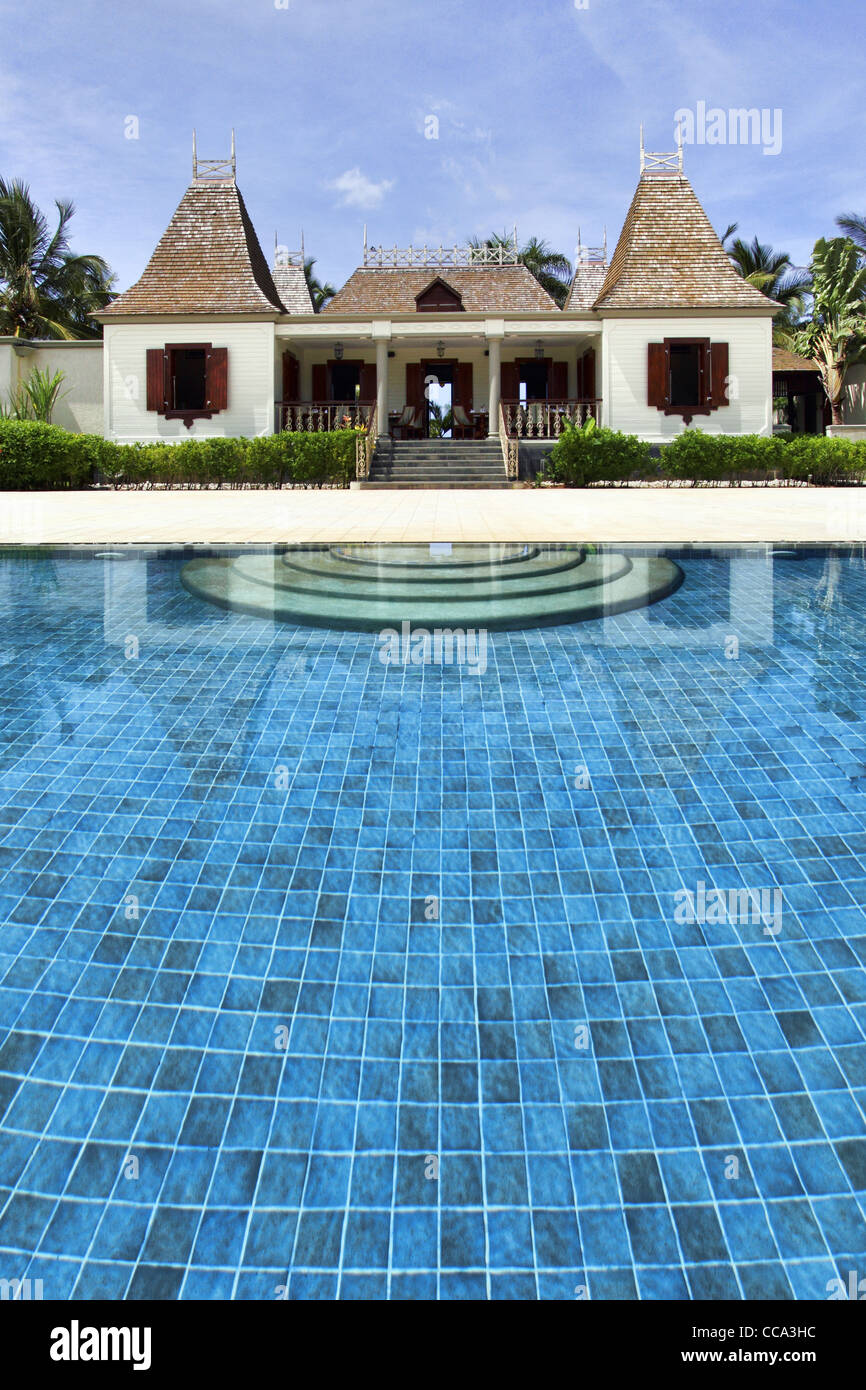 Colonial house near swimming pool stock photo royalty for Swimming pool close to house