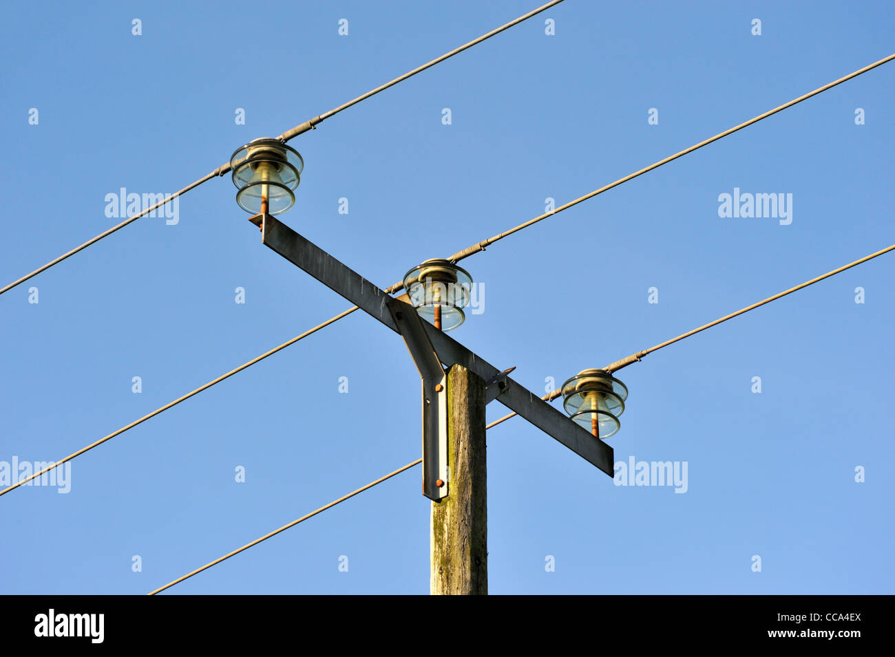 Electric Poles Power Lines : Overhead low voltage electrical power lines on wooden pole