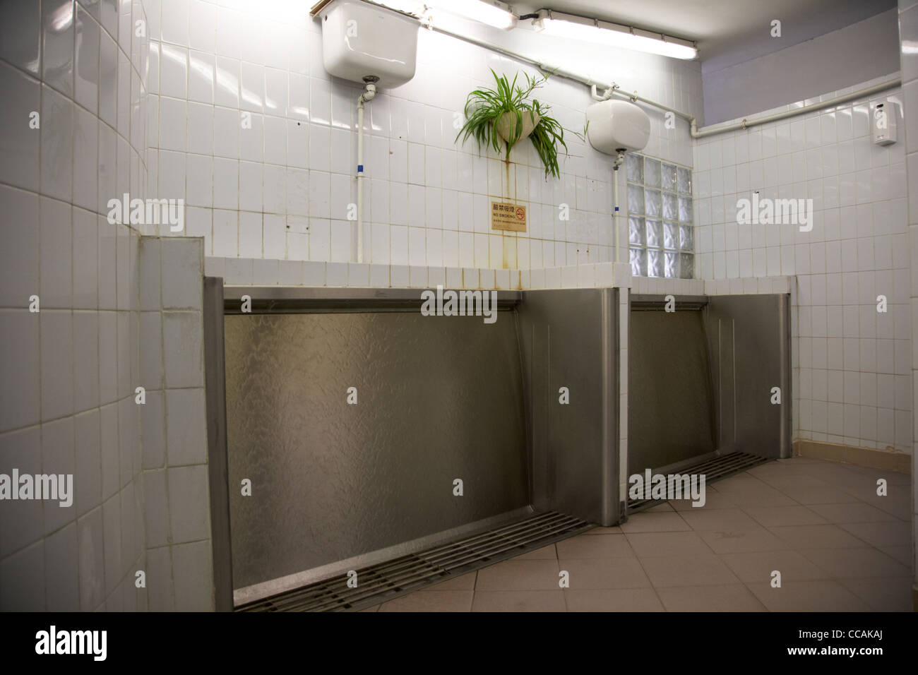 sanistall public waterfall urinals in a public toilet hong kong hksar stock photo royalty free. Black Bedroom Furniture Sets. Home Design Ideas