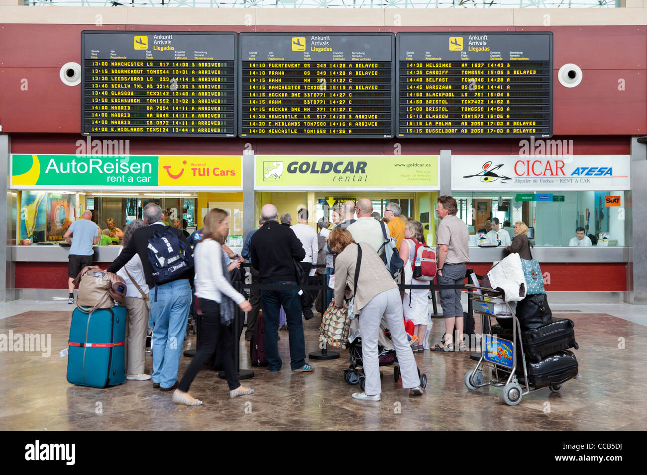 Car rental offices at tenerife south airport with queues of people canary islands spain