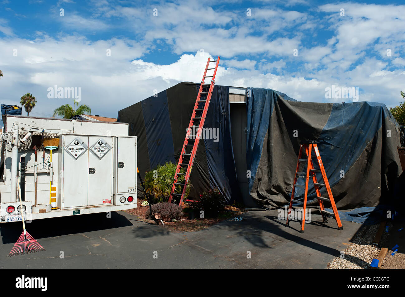 A fumigation truck in front of a house in the process of being tented for pest control & A fumigation truck in front of a house in the process of being ...