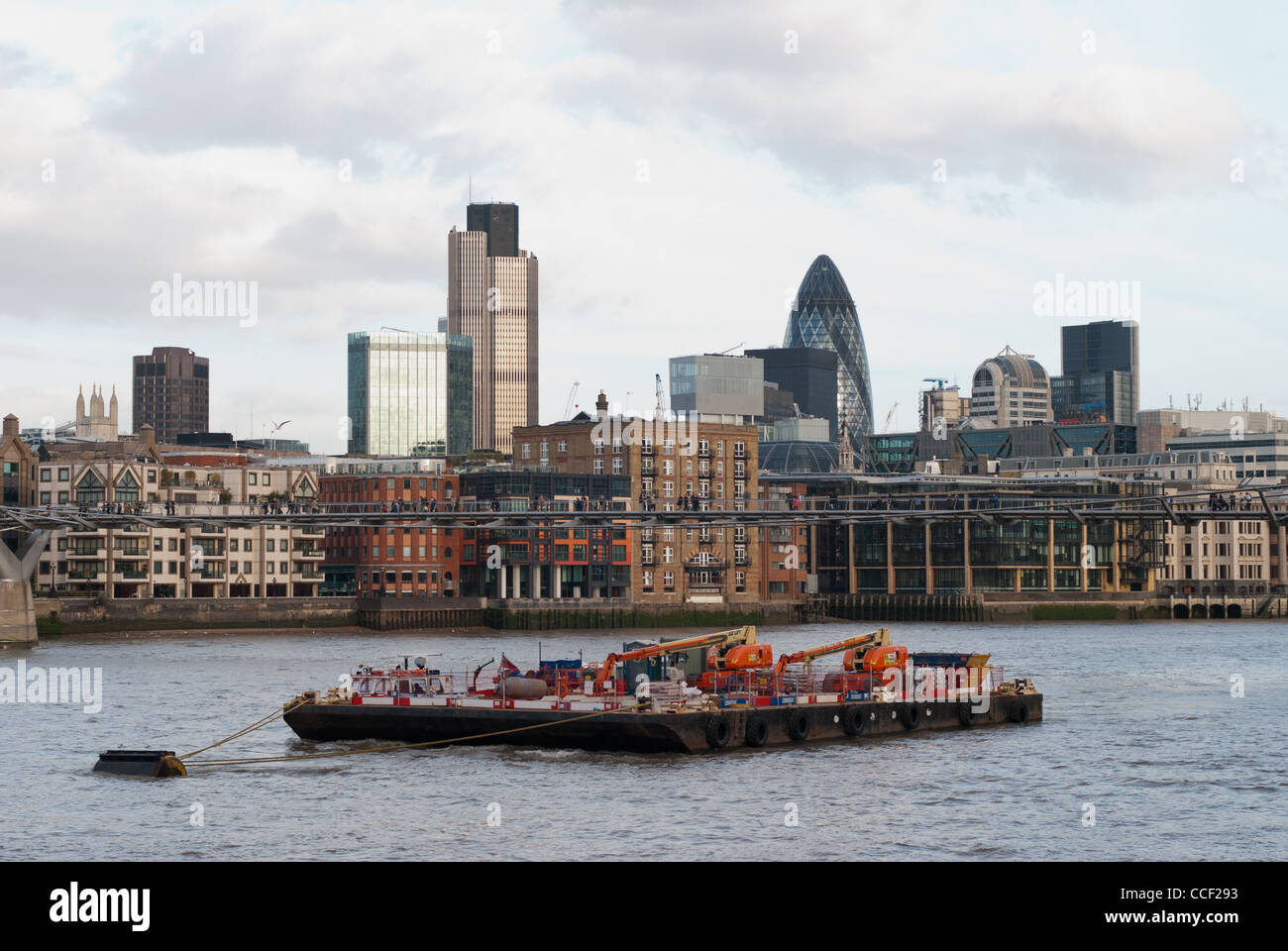 Commercial Barge On The River Thames With The City In The