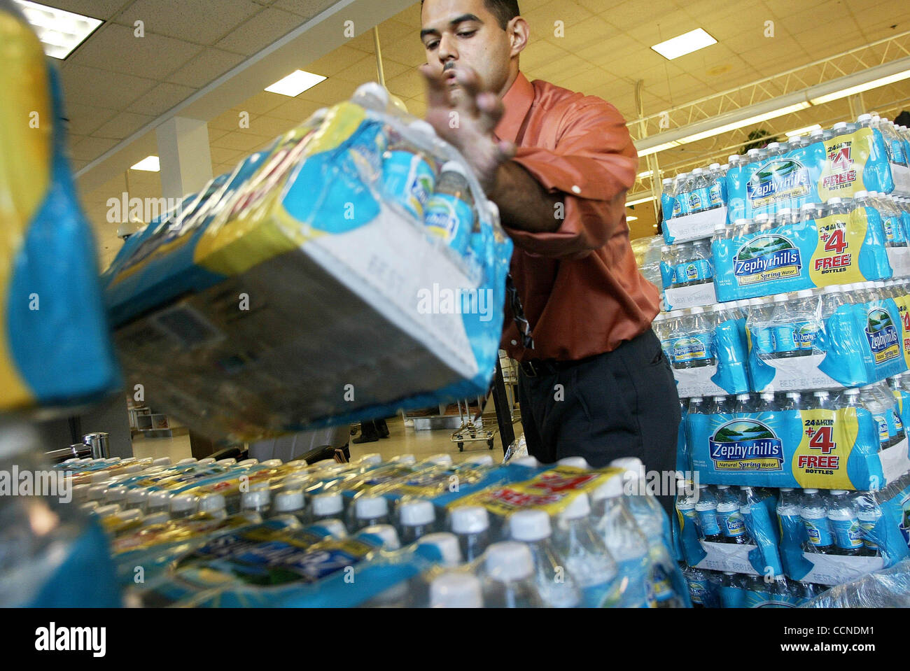 hur jeanne prep west palm beach jorge vidal assistant grocery manager for publix on southern works loading up bottles of water at publix