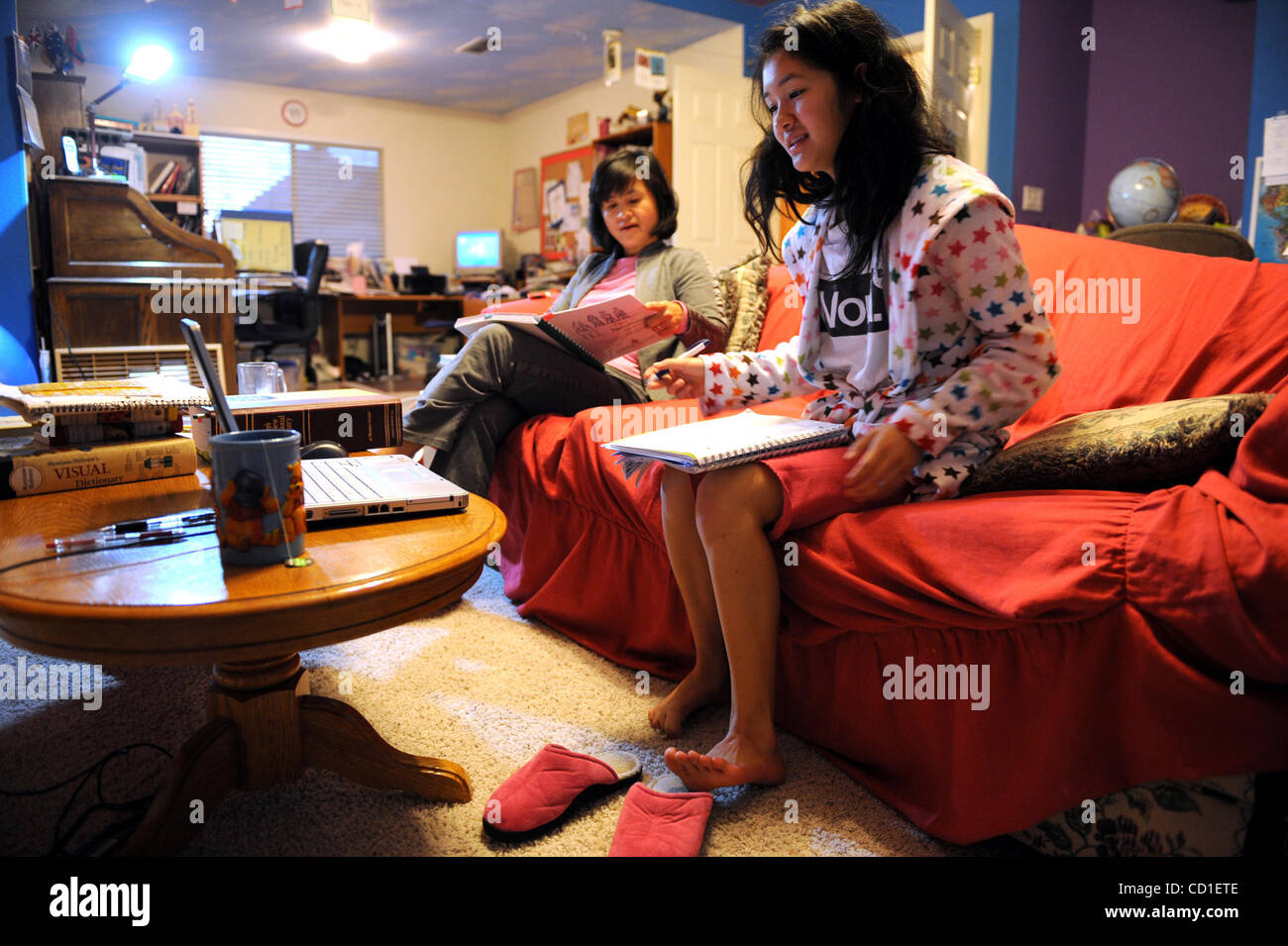 merriam webster stock photos merriam webster stock images alamy lede spelling bee peggy kao reads words to her daughter josephine kao