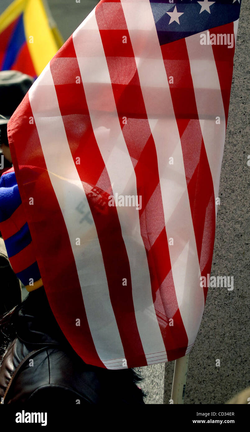 Pema Lhano is shrouded in the American flag as she ...