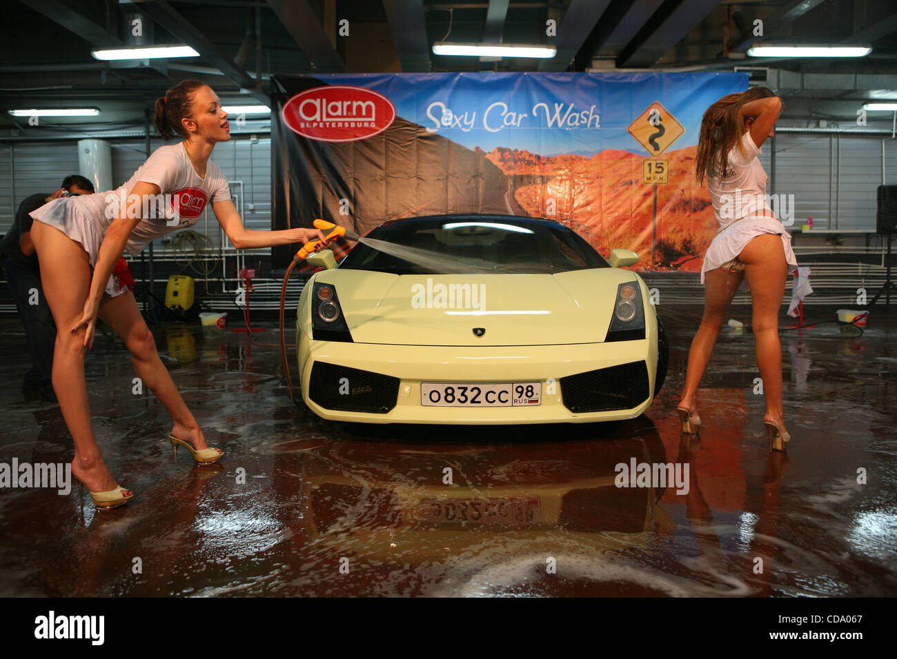 alarm sexy car wash action at one of st petersburg s car wash stock photo royalty free image. Black Bedroom Furniture Sets. Home Design Ideas