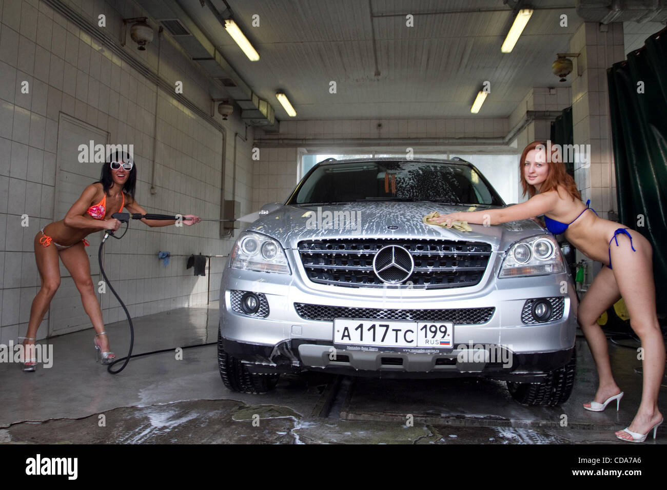 Bikini car wash erotic action at one of moscow s car wash for Mercedes benz car wash free
