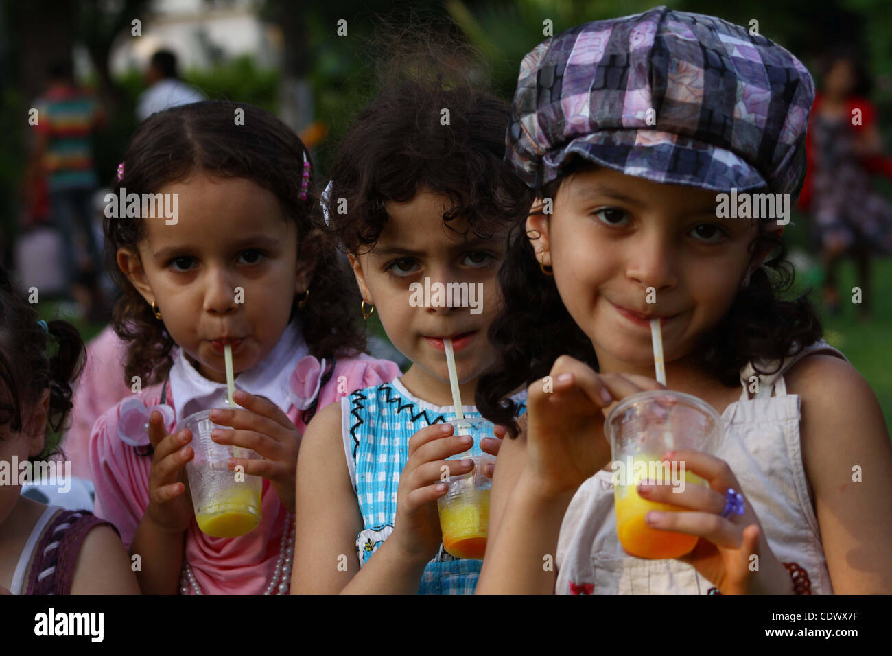 Download Gaza Eid Al-Fitr Feast - palestinian-children-enjoy-a-ride-at-an-amusement-park-on-the-second-CDWX7F  Collection_531472 .jpg