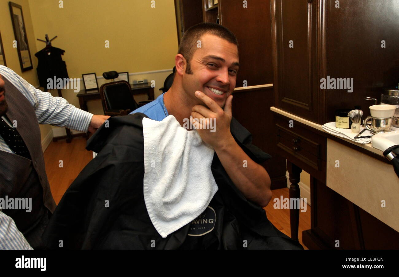 nick swisher new york yankees outfielder getting his beard shaved at stock photo royalty free. Black Bedroom Furniture Sets. Home Design Ideas