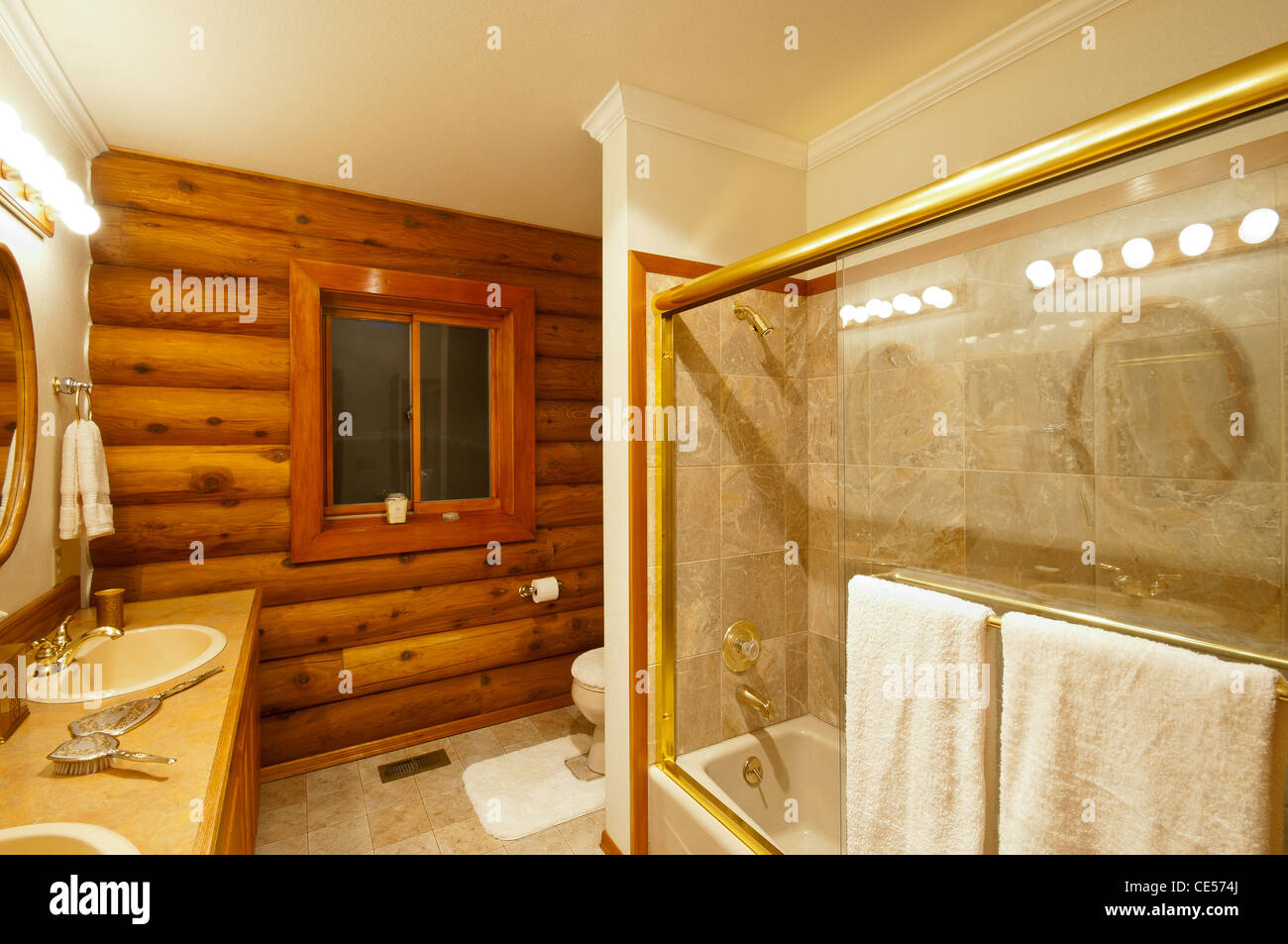 Bathroom In Luxury Log Cabin Featuring Tub With Glass Shower Enclosure,  Cedar Logs, Sinks And Counter Top