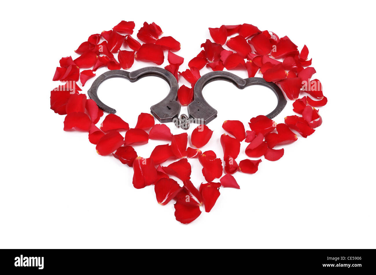 Rose petals arranged in the shape of a heart and an open heart rose petals arranged in the shape of a heart and an open heart shaped handcuffs buycottarizona Gallery