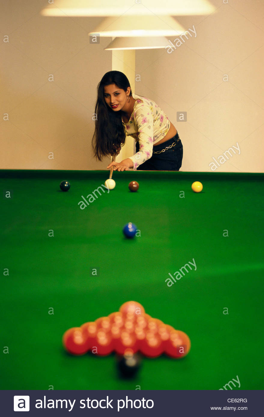Setting Up A Pool Table Rack Of Pool Balls Set Up On Table And Man Playing With Cue Ball