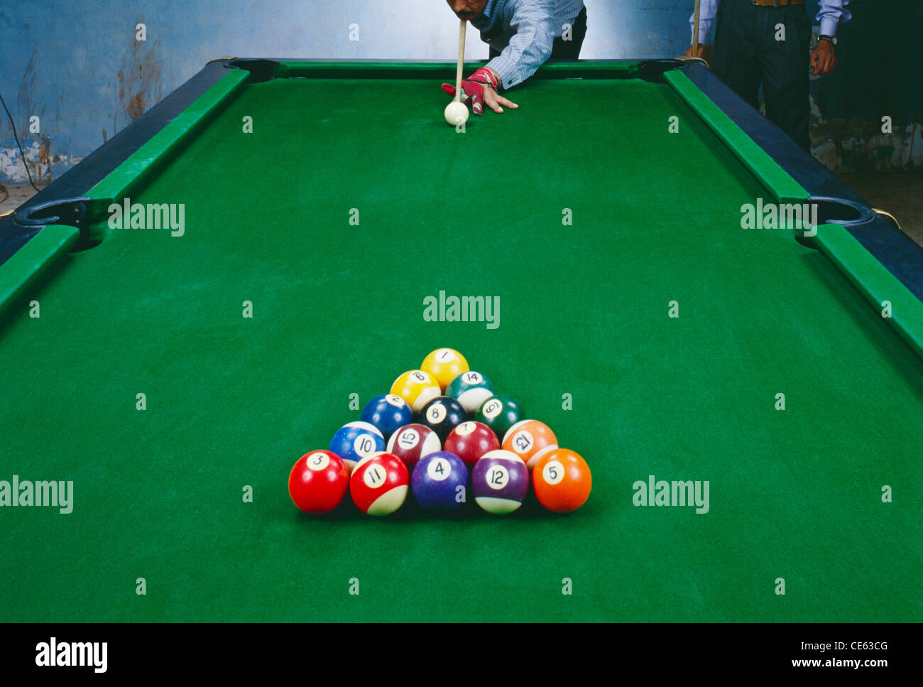 Rack of pool balls set up on table and man playing with cue ball - Stock  sc 1 st  Alamy & Close Up Of Hand And Cue On Pool Table Stock Photos \u0026 Close Up Of ...