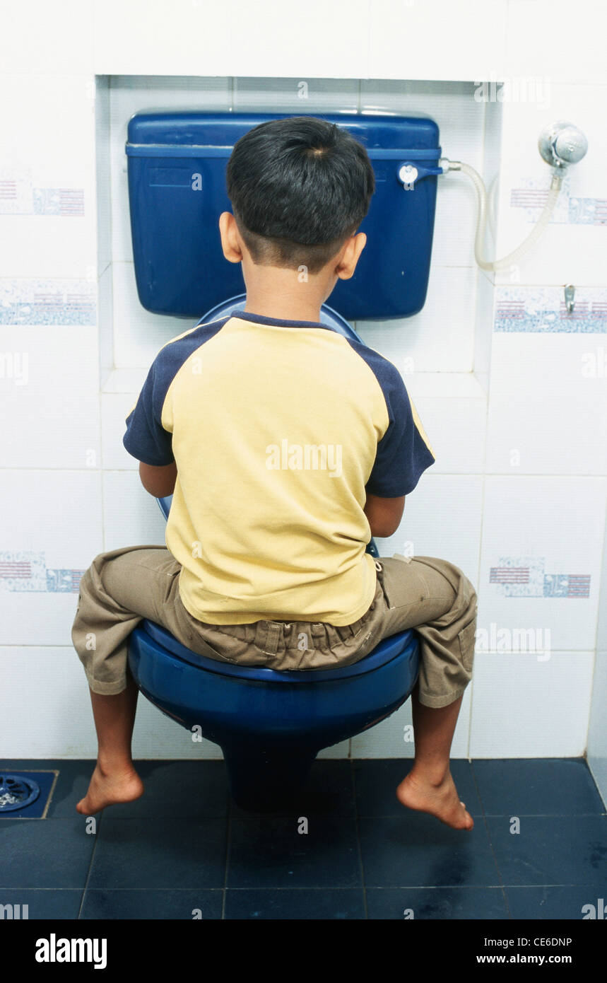 young boy and the toilets small young boy sitting on commode in toilet MR#152