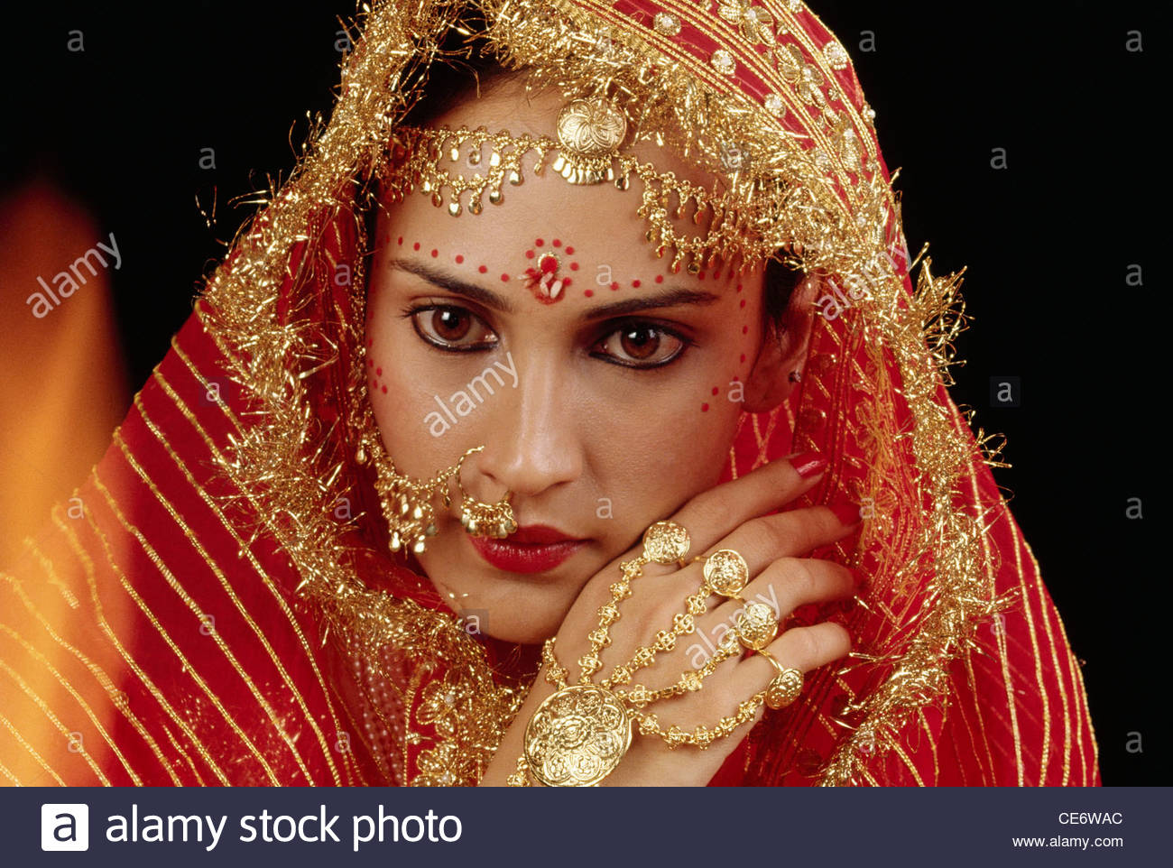 NNA 85215 : indian bride wearing gold hand jewellery gold nose ...