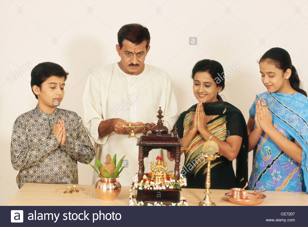 Indian hindu family of four ; Husband ; Wife ; Son ...
