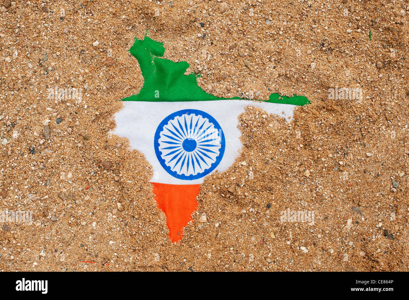 India Flag Map: Indian Flag Showing Through Sand Shaped Like The Map Of