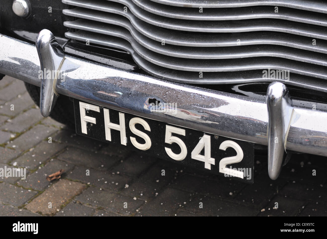 Old British classic car front chrome bumper and black and white ...